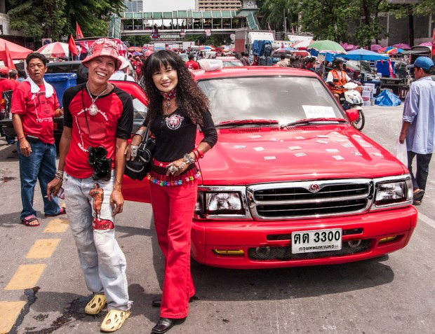 Red couple with a red pickup