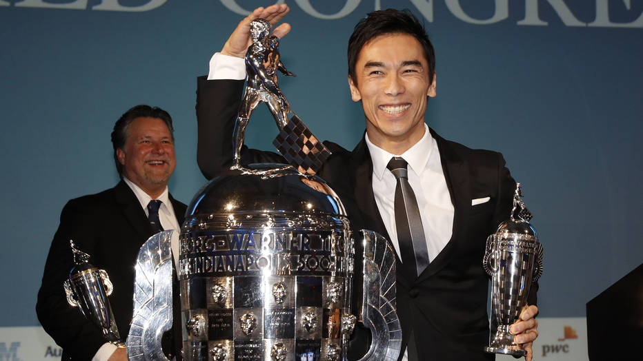 Takuma Sato and Michael Andretti receive their Baby Borg trophies.