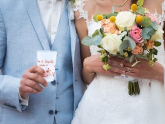 Married couple holding green goblet reusable cup
