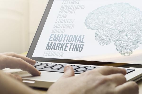 Emotional marketing feedback on a laptop screen