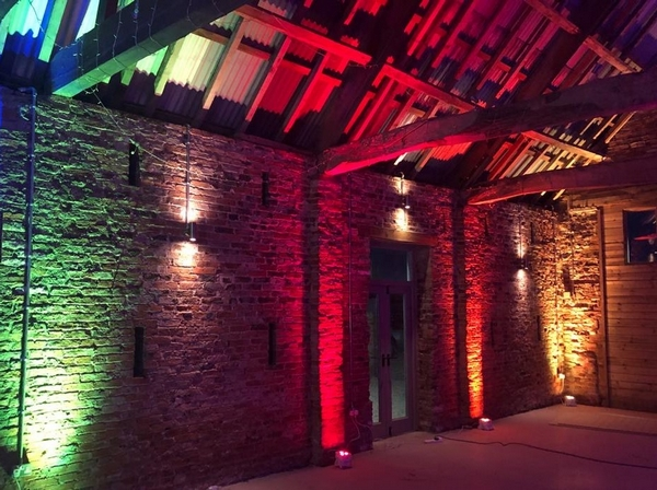Sedgewell Barn lit up with rainbow lights