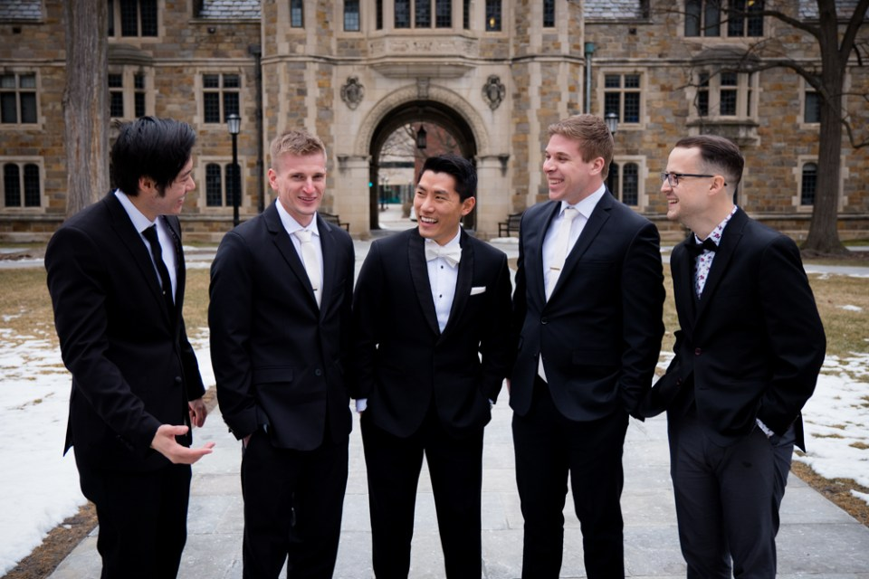 Groom and grommsmen chatting in Ann Arbor Law Quad