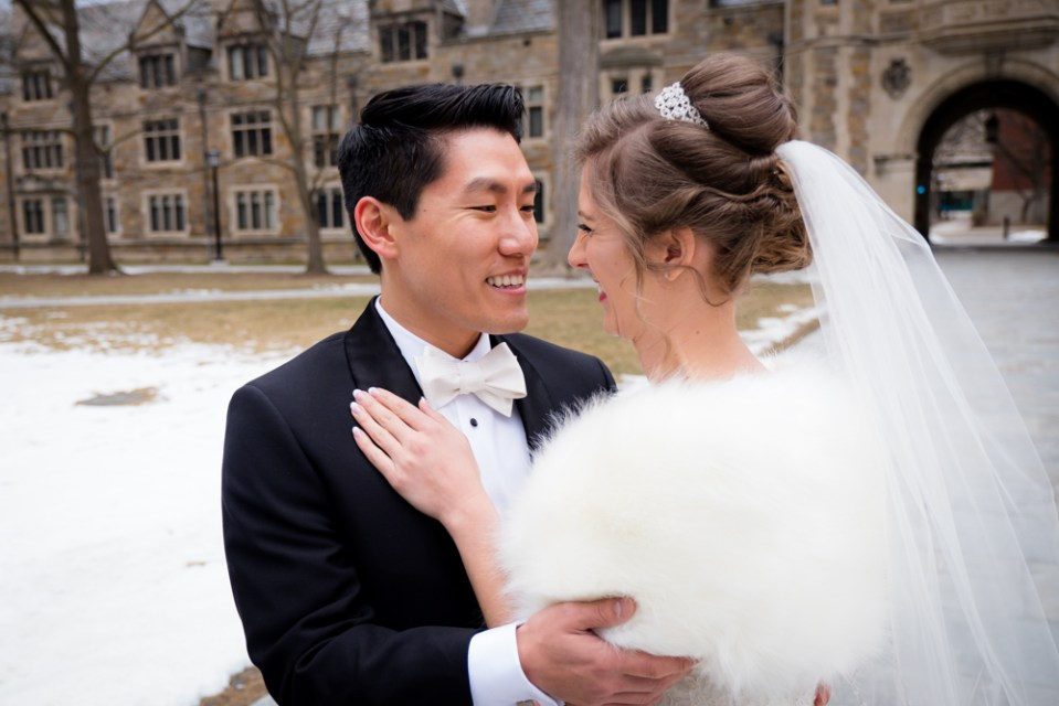 Sweet laughter between bride and groom in Ann Arbor Law Quad