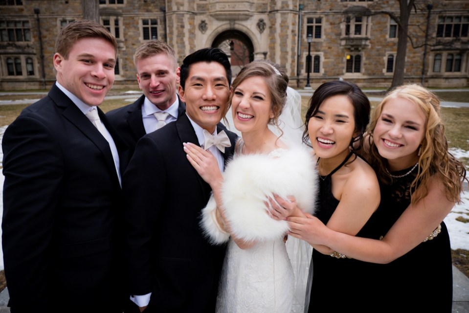 Cozy hugs from bridal party in Ann Arbor Law Quad