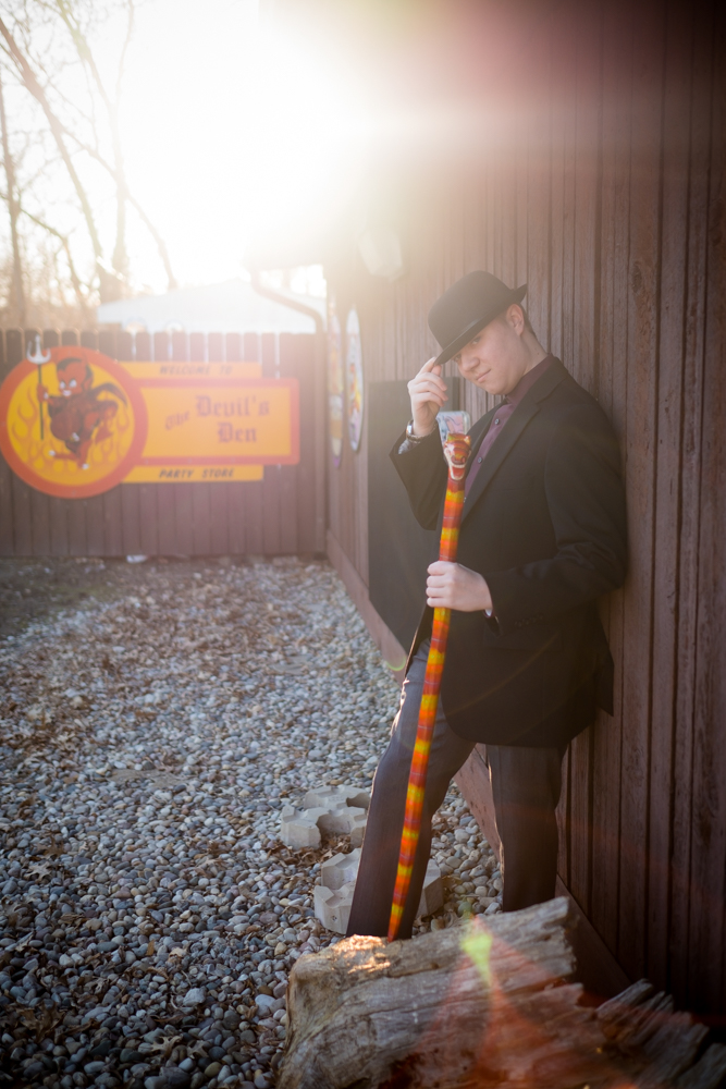 Teenager with a snake cane and top hat in Hell Michigan