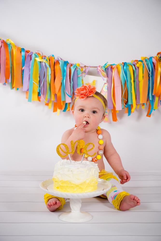 Birthday girl taking one finger of cake
