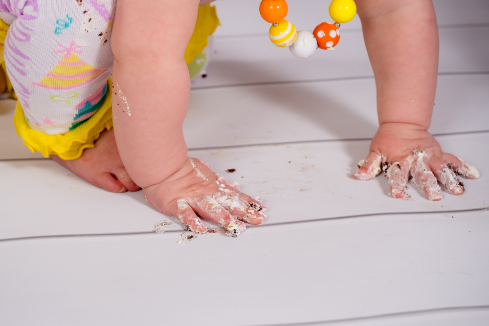 Little hands full of frosting