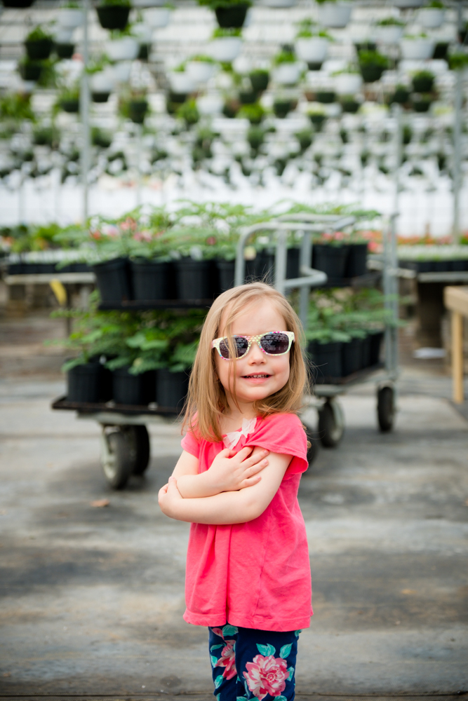 Little girl with sunglasses smiling