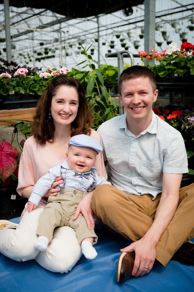 Adorable family with a baby boy smiling big