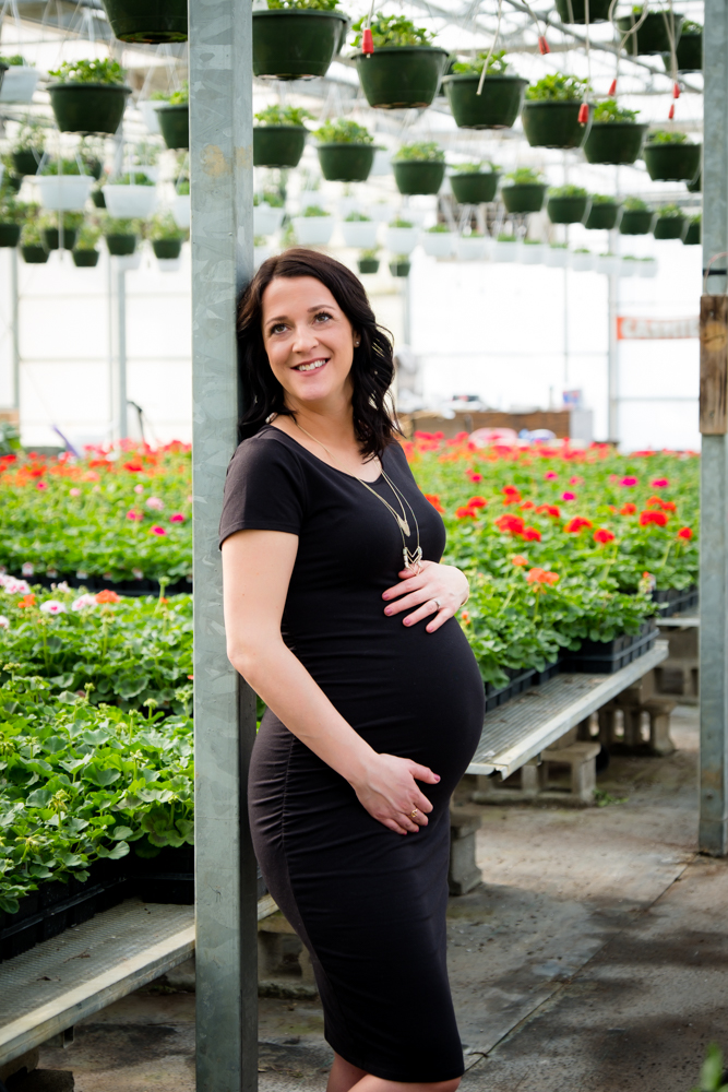Beautiful pregnant woman in a greenhouse