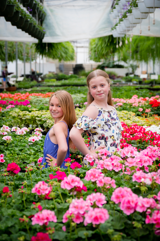 Two sweet girls surrounding by flowers
