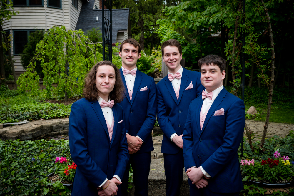 The four groomsmen in navy blue suits