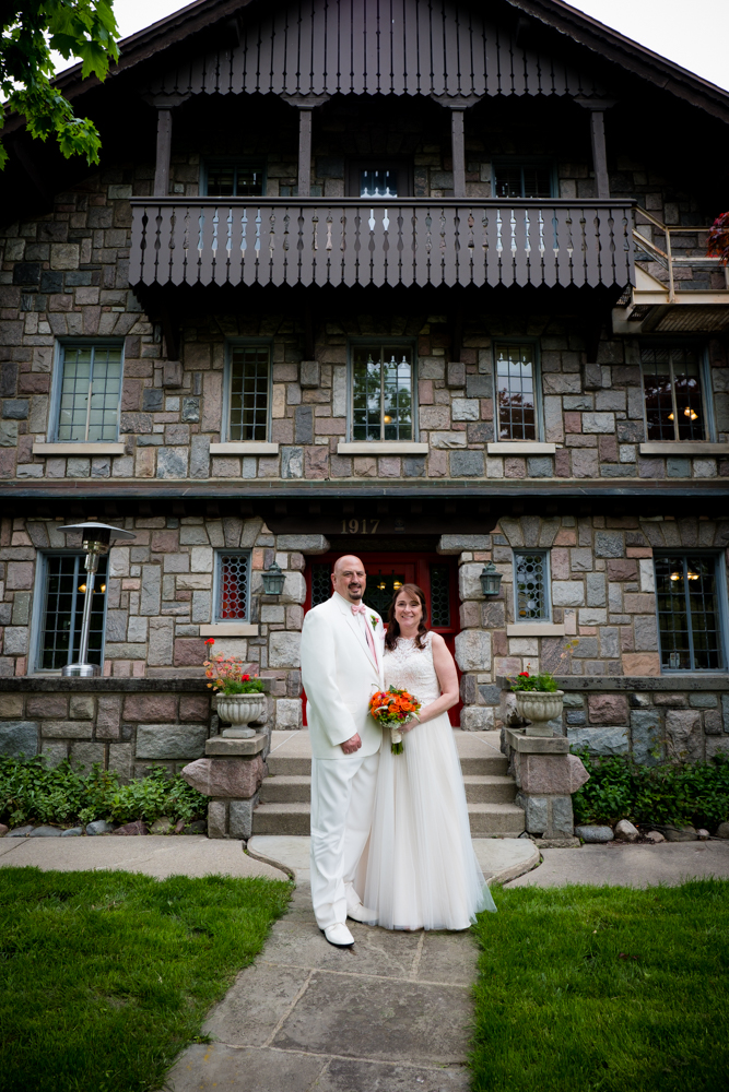 Bride and groom in front of the Stone Chalet Bed and Breakfast in Ann Arbor