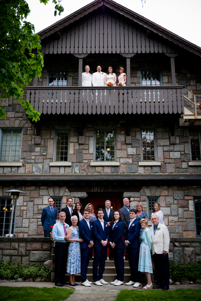 Full family photo with bride, groom, best man and maid of honor on the balcony of the Stone Chalet Bed and Breakfast in Ann Arbor