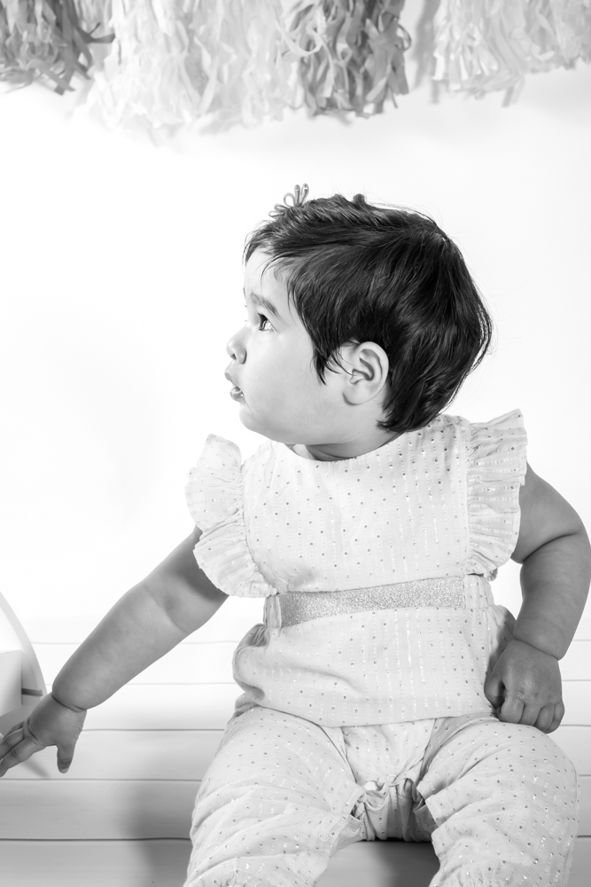 Little girl looking to the side in black and white