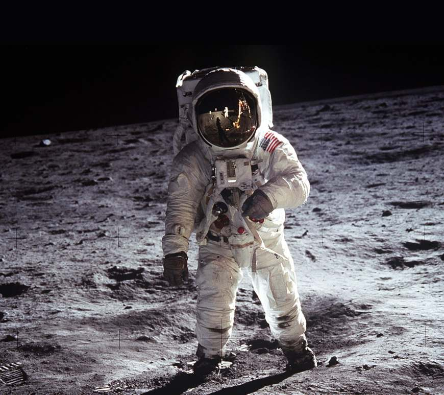 "Astronaut Buzz Aldrin, lunar module pilot, walks on the surface of the Moon near the leg of the Lunar Module (LM) ""Eagle"" during the Apollo 11 exravehicular activity (EVA). Astronaut Neil A. Armstrong, commander, took this photograph with a 70mm lunar surface camera. While astronauts Armstrong and Aldrin descended in the Lunar Module (LM) ""Eagle"" to explore the Sea of Tranquility region of the Moon, astronaut Michael Collins, command module pilot, remained with the Command and Service Modules (CSM) ""Columbia"" in lunar orbit."