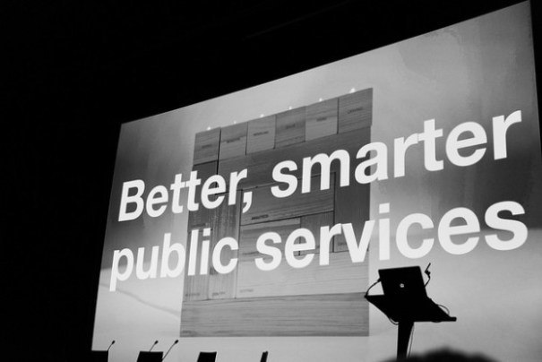 Big screen at a Sprint event reading 'Better, smarter public services""