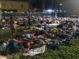 Large group of people sleeping outside in church courtyard. Displaced people form Mosul or villages on the Nineveh plain.