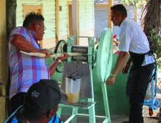 Cubans operating a press to extract the sugary juice from the cane, Havana, Cuba, 2017.