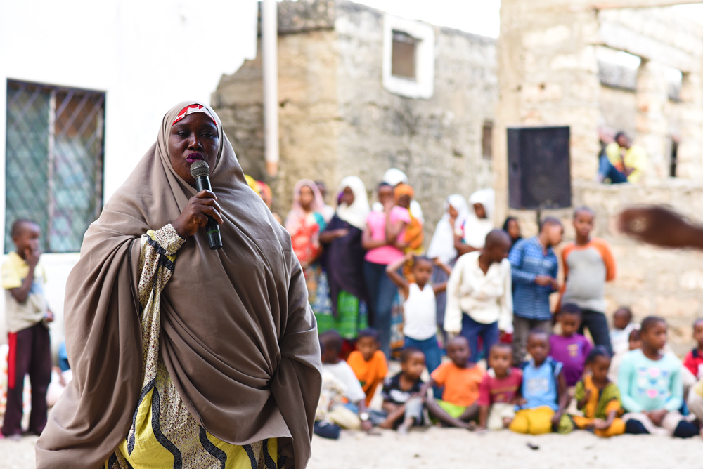A woman in lamu at a public meeting speaking