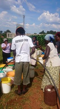 MP helps residents collect water