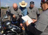 Bikers pray for each other before kickstands go up for a benefit ride to benefit HorsePowerKids.