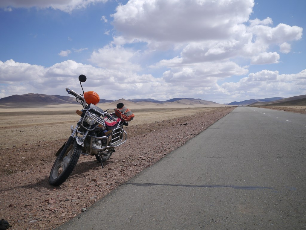 Riding a Motorcycle across the Mongolian steppes from Tsetserleg to Tariat