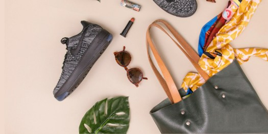 Blog banner with one shoe, leaf, sunglasses, and a bag on the nude background