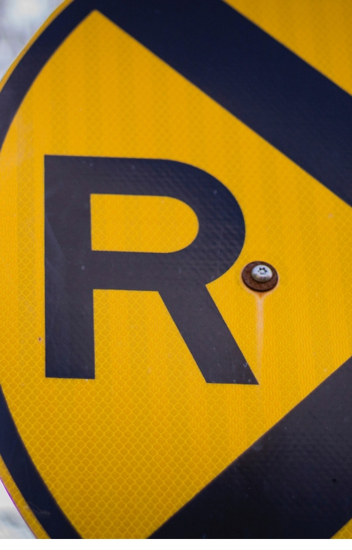 Yellow background with the letter R written in black