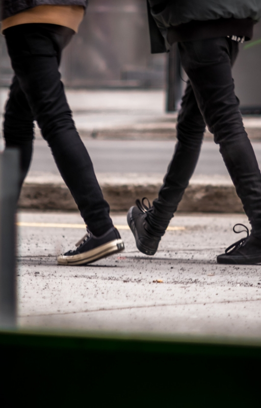two people walking together in sync