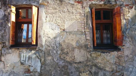 two open windows on a wall