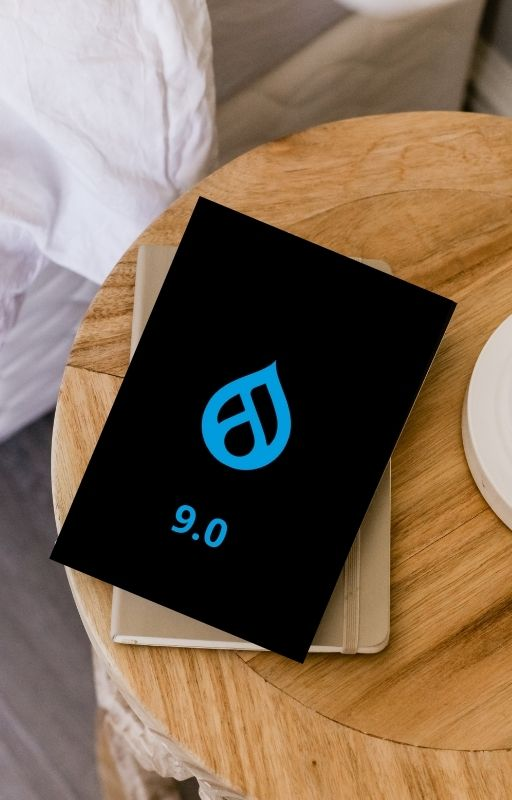 Black diary with Drupal 9 logo on it