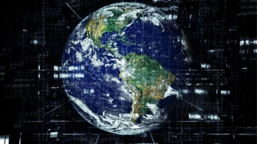 The picture shows the Earth with many signs and numbers revolving around it showcasing the advent of technology.