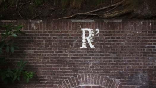 Letter R written on a wall