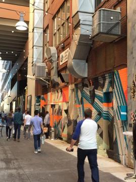 Vivid, mural-bedecked alleyway in downtown Detroit.
