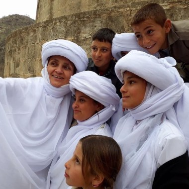 Dr Nemam with Yazidi children dressed in traditional Yazidi dress for special celebrations