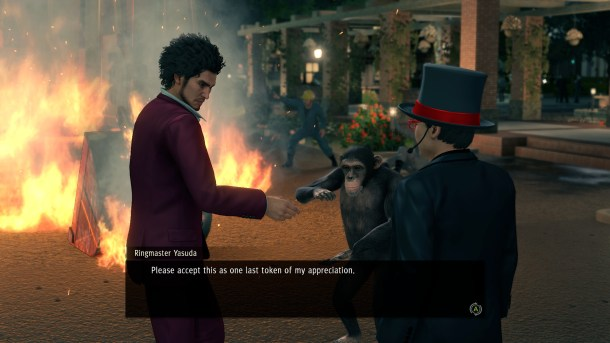 Yakuza: Like a Dragon | Ichiban accepts an item from an NPC while standing in front of a construction fire