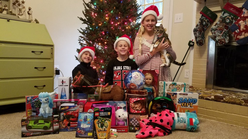 Even the kids and the kitty were involved raising gifts!