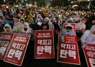 Sul-coreanos vão às ruas após aprovação do impeachment 6