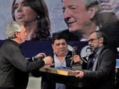 Alberto Fernández ayer en Río Gallegos recibía de manos de Rudy Ulloa una estatuilla de Néstor Kirchner – Foto: