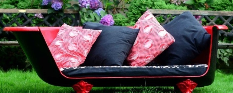Create a sofa out of a broken bathtub.