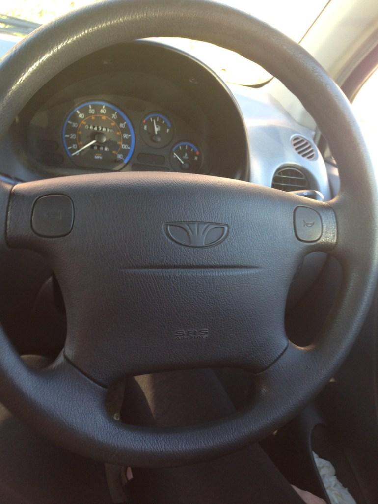 This steering wheel looks like a judgmental sloth.