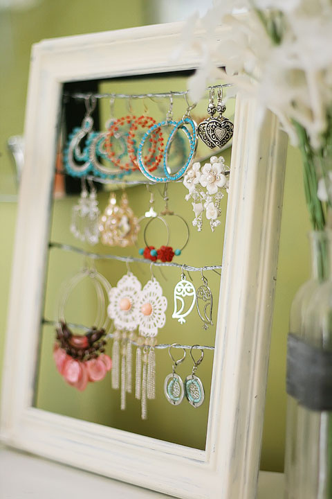Get rid of the broken glass and turn your picture frame into an earring holder display.