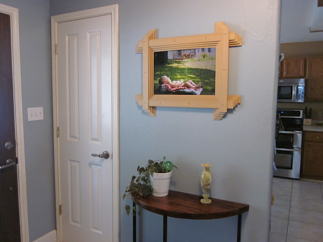 Combine broken mini blinds together to create a picture frame.