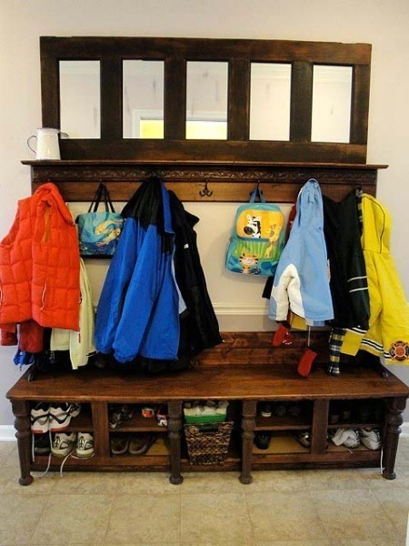 Turn a broken door into a coat rack.