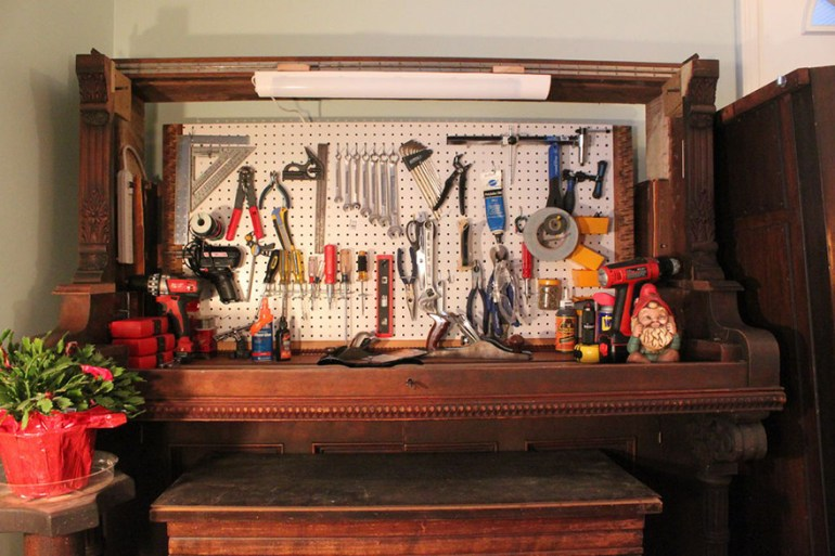 Turn a broken piano into a hidden workbench.