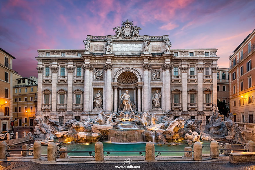 Admiring The Trevi Fountain In Rome, Italy