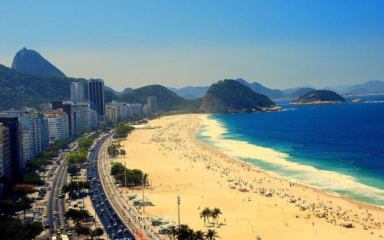 Sunbathing In The Famous Beach Of Rio De Janeiro, Brazil