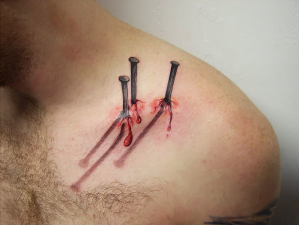 Nails hammered into the shoulder.