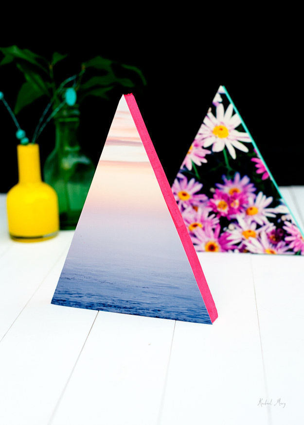 Attach your favorite photos to wooden triangles to make cool table centerpieces.